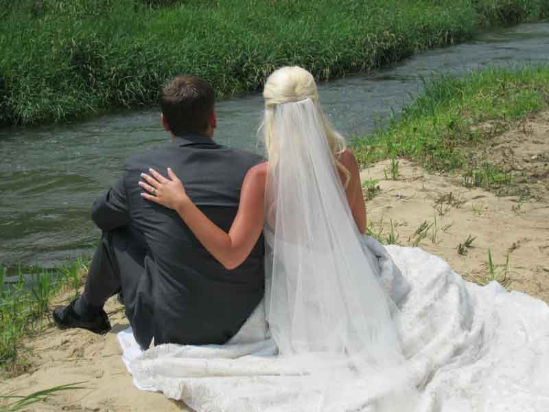 Wedding Couple along stream at Winnebago Valley Hideaway